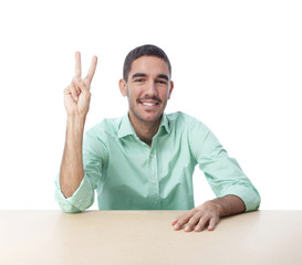 Young man with victory gesture