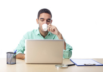 Guy drinking coffee at work