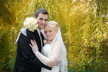 Loving wedding couple outdoor.