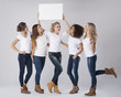 Casual girls with empty whiteboard above their heads