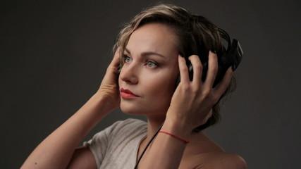Young beautiful girl enjoying music.