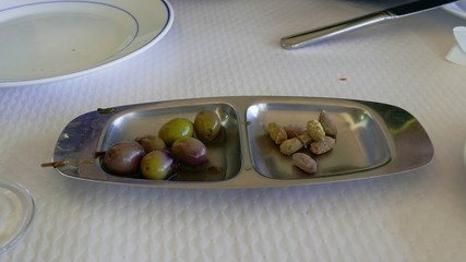 Women and Men Hands Taking Olives from Bowl, closeup