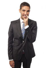 Businessman with finger in the nose
