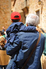 Child in the arms of his grandfather