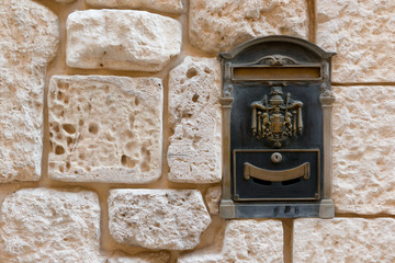 Letterbox in ancient Medina stone wall in Malta