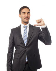 Satisfied businessman pointing