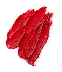 Red colour lipstick stroke on white paper