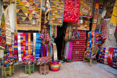 Fotobehang Marokko Colorful fabrics on the Agadir market in Morocco