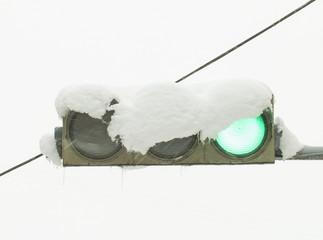 Traffic light in the snow. Stock Image macro.