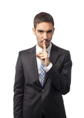 Young businessman silence gesture