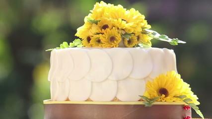 white creamy cake decorated with yellow chrysanthemum flowers ro