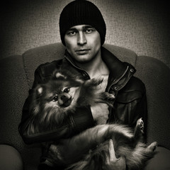Young brutal man with a dog