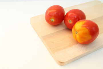 tomatoes on the chopping block