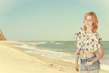 beautiful girl in shorts on the beach