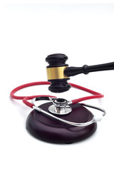 GAVEL WITH A STETHOSCOPE ON THE BASE