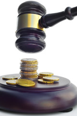 GAVEL WITH COINS ON THE BASE
