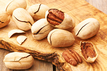 Pecan nuts on wooden table