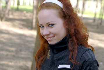 Cute red-haired girl smiling