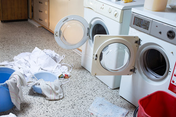 two washing machines with the dirty laundry of the kindergarten