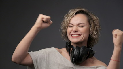 Portrait of beautiful girl in headphones. Relaxation, emotions.