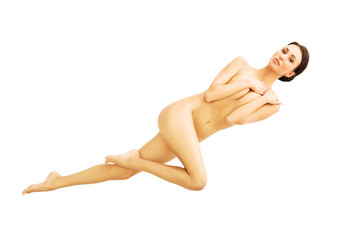 Above view nude woman lying down covering breast