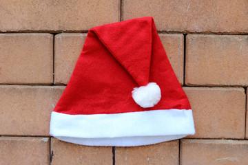 santa hat on brick wall