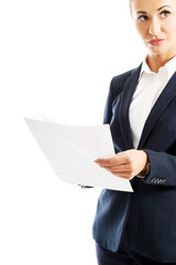 Portrait businesswoman holding sheets of paper