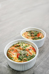 An oven omelette with baby spinach and tomatoes