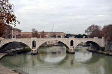 Rome, Italy. View on a bridge across the Tiber on a cloudy day