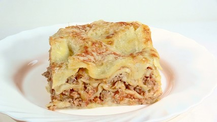 Italian cuisine. Meat lasagna  on the white plate