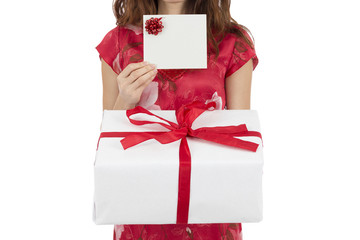 Woman showing gift card and gift box