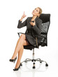 Businesswoman sitting on a chair and pointing