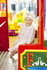 sitting toddler on carousel
