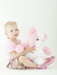 sitting toddler with a teddy bear