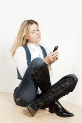 sitting woman with mobile phone