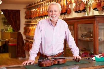 Portrait Of Violin Maker In Shop