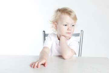 portrait of little girl sitting at table