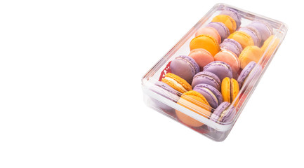 French macaron in a plastic box container