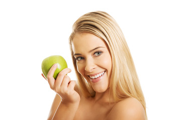 Smiling beautiful woman holding an apple