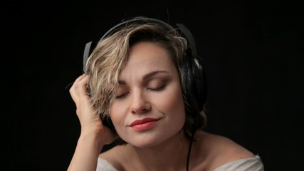 Young beautiful girl enjoying music. Relaxation, emotions, rest.