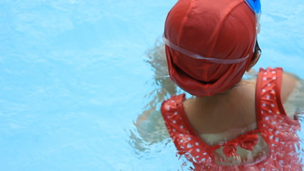 Little girl in swimming pool, Summer outdoor
