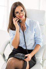Pretty Businesswoman Phoning