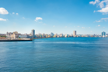 The skyline of Havana with the ocean on the foreground
