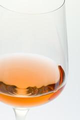 wineglass with rosé wine