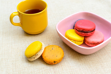 Colorful macaroons and a cup of coffee