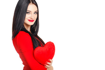 Portrait of a beautiful woman with red heart in hands.