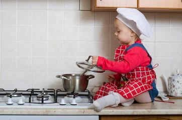 Little girl chef preparing lunch