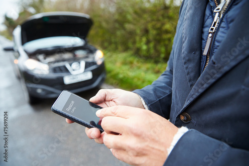 canvas print picture Motorist Broken Down On Country Road Phoning For Help