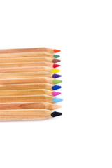 stacked colored pencils isolated on white