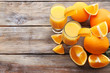 canvas print picture - Freshly squeezed orange juice on wooden table